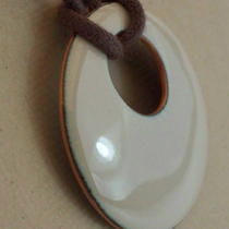 Bone Enamel Dome Pendant With Cord Photo
