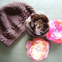 Brown Crochet Beanie With Three Beautiful Flower Clips Photo