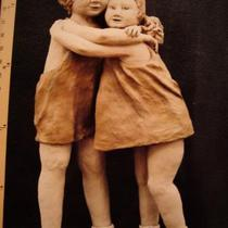 Clay sculpture of two girls Photo