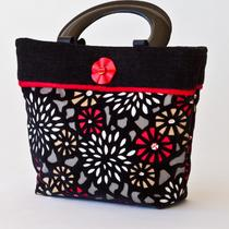Contemporary Black and Red Floral Handbag Photo