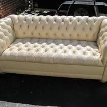 Leather chesterfield style sofa Photo