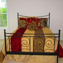 Queen size bedspread with pillows Photo