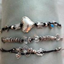Sterling Silver, Gemstone and Leather braceletes Photo