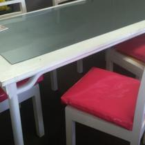 White lacquer table with chairs, and custom upholstered pink patent chair cushions Photo