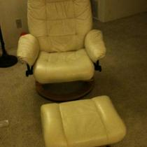 White leather reclining chair and stool Photo